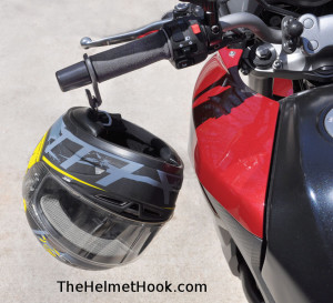 Helmet Hanging From Red Motorbike