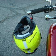 Yellow Helmet Hanging From Red Motorcycle
